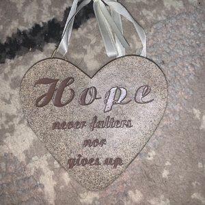 """Hope never falters nor gives up"" ornament."